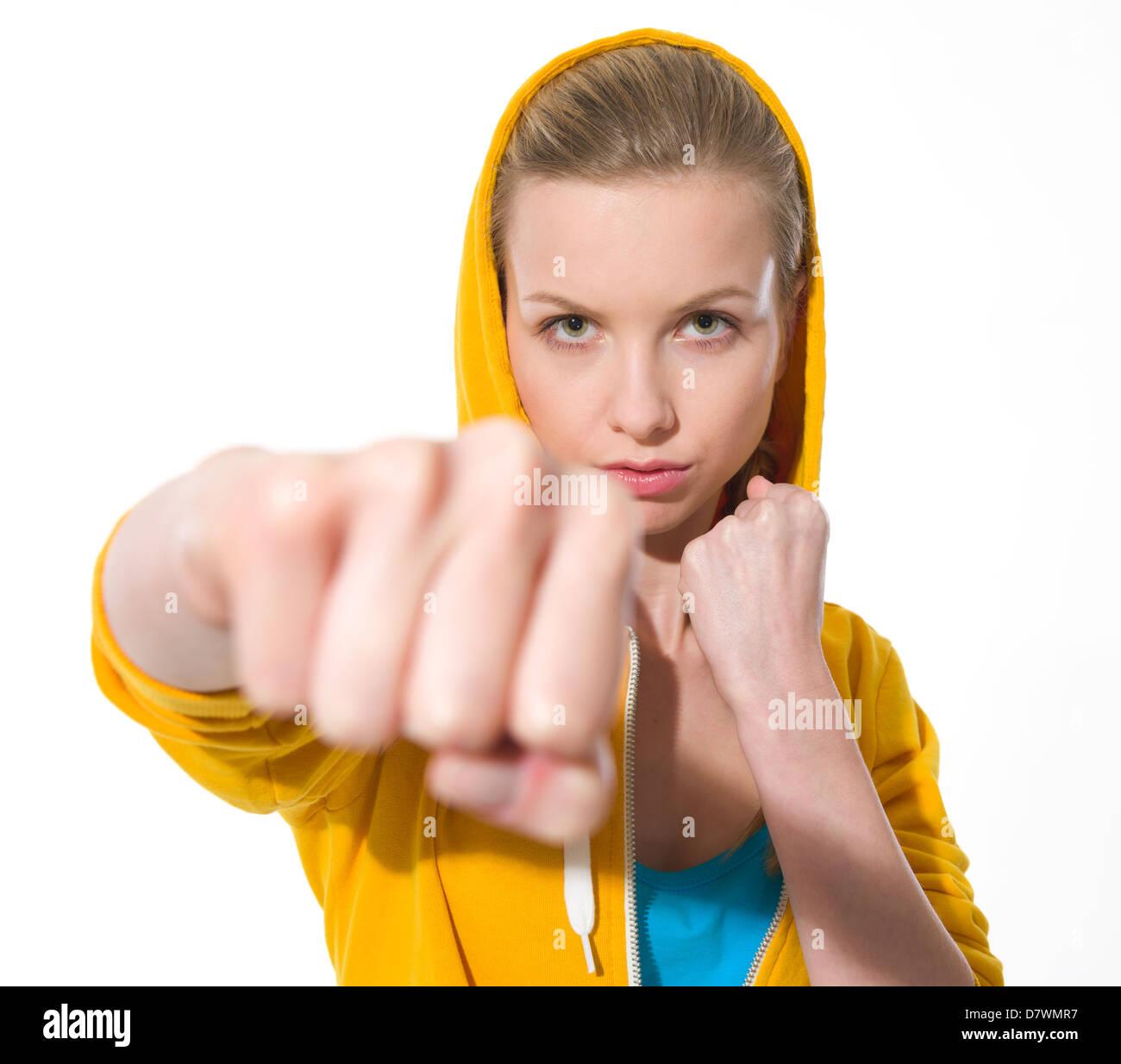 Teenager girl punching - Stock Image