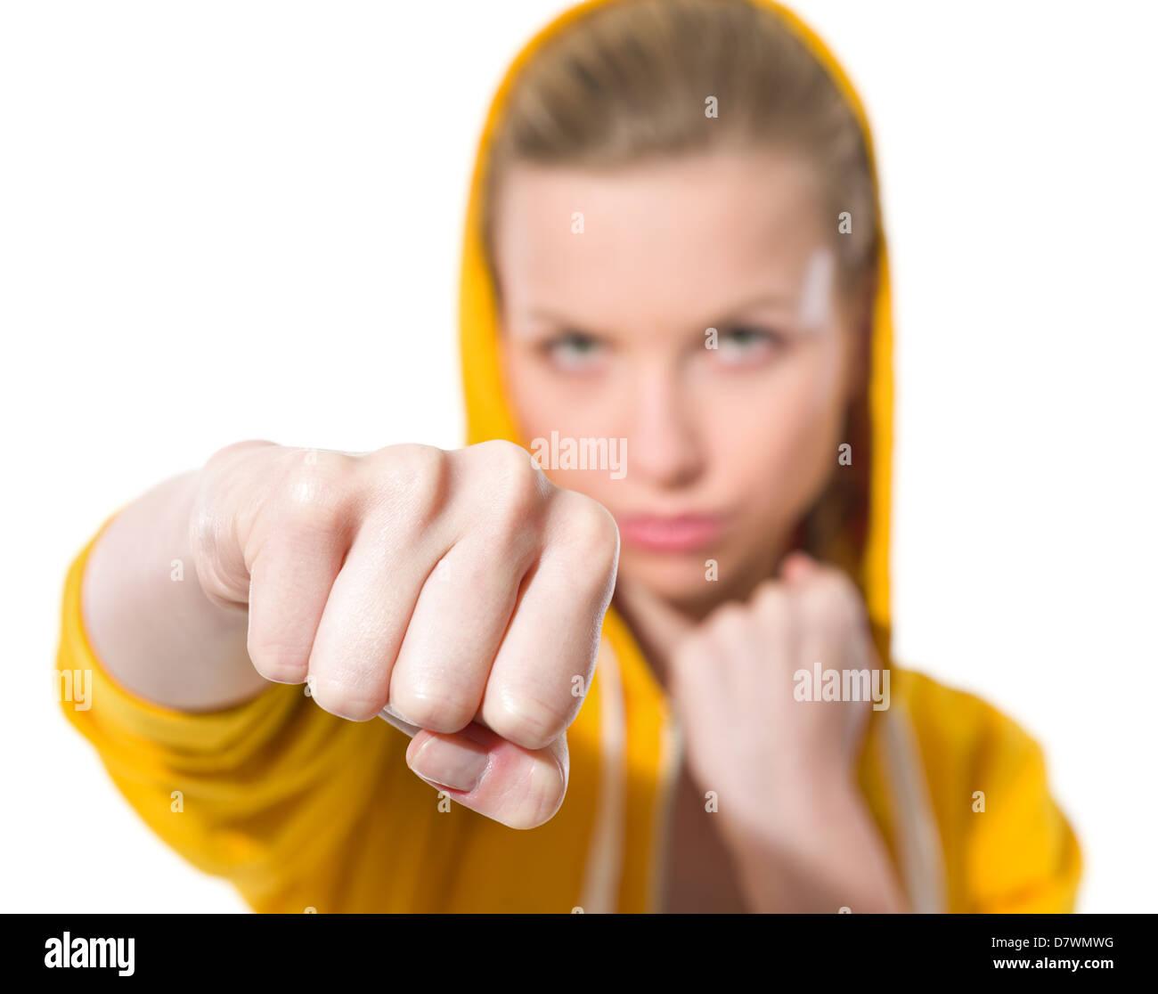 Closeup on teenager girl punching - Stock Image