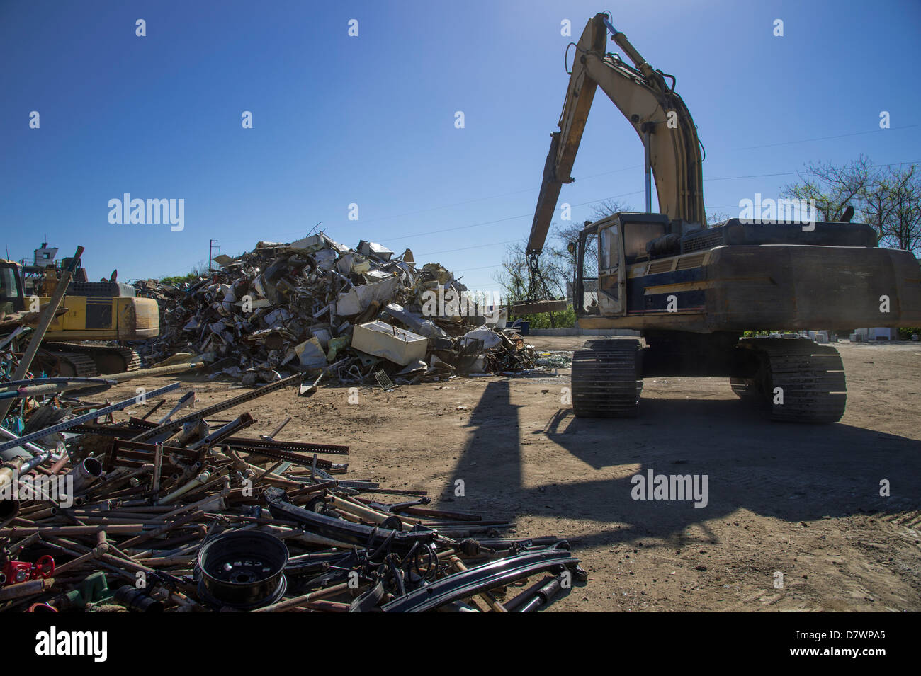 Crane With Magnet Picking Up Scrap Metal For Recycling In Junk Yard - Stock Image