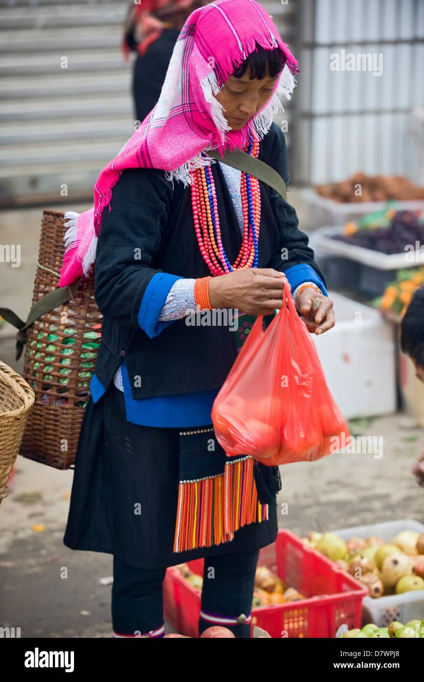 Akha woman at Xiding weekly market, in the hills west of Menghai, Xishuangbanna, Yunnan, China. - Stock Image