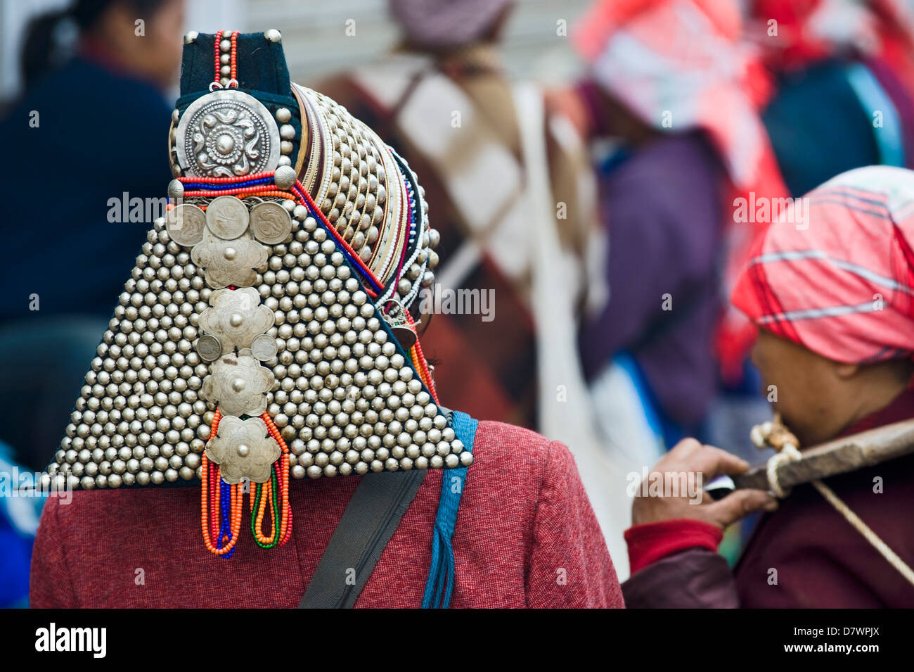 Akha woman at Xiding weekly market, in the hills west of Menghai, Xishuangbanna, Yunnan, China. - Stock Image