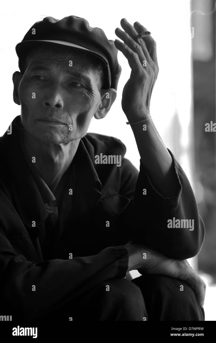 The spiritual leader of Laomange, a Bulang village on Bulangshan, a tea mountain west of Menghai, Xishuangbanna, - Stock Image