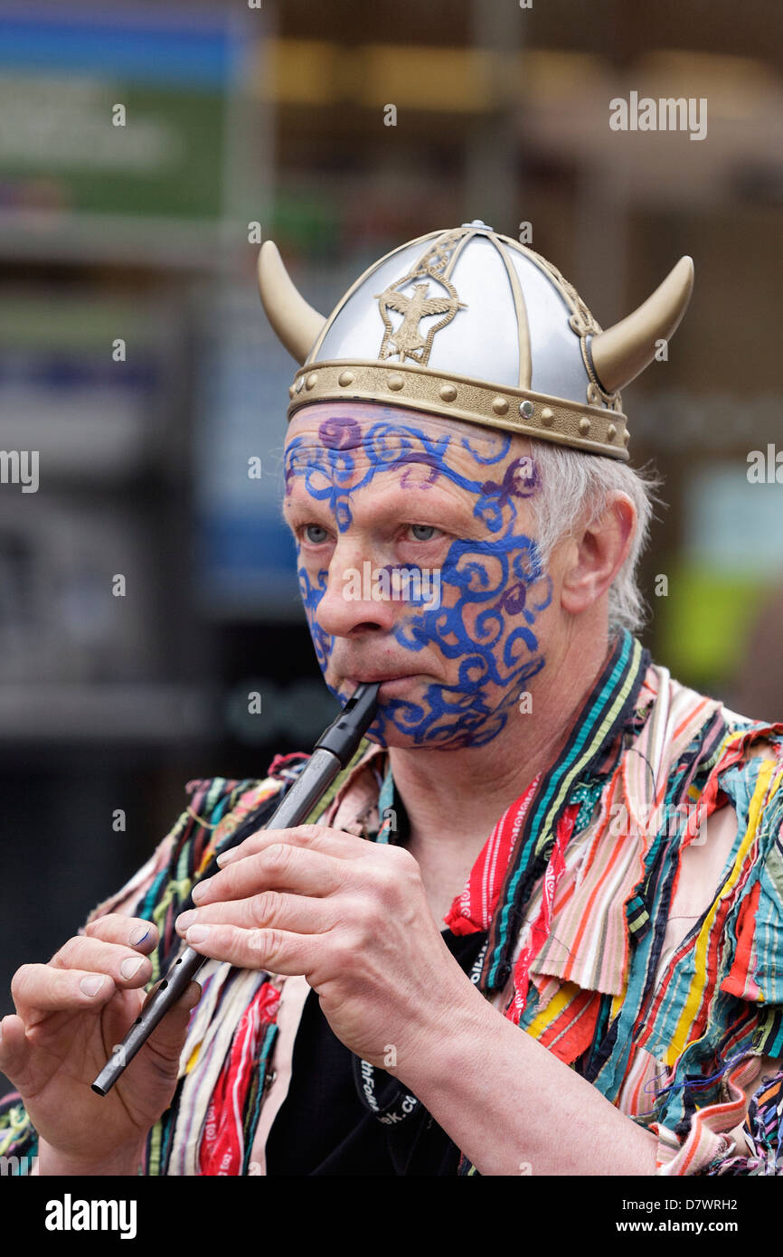 A musician with a painted face and a viking helmet performs on the opening day of the 2012 Folk Festival,Chippenham,Wiltshire,UK - Stock Image