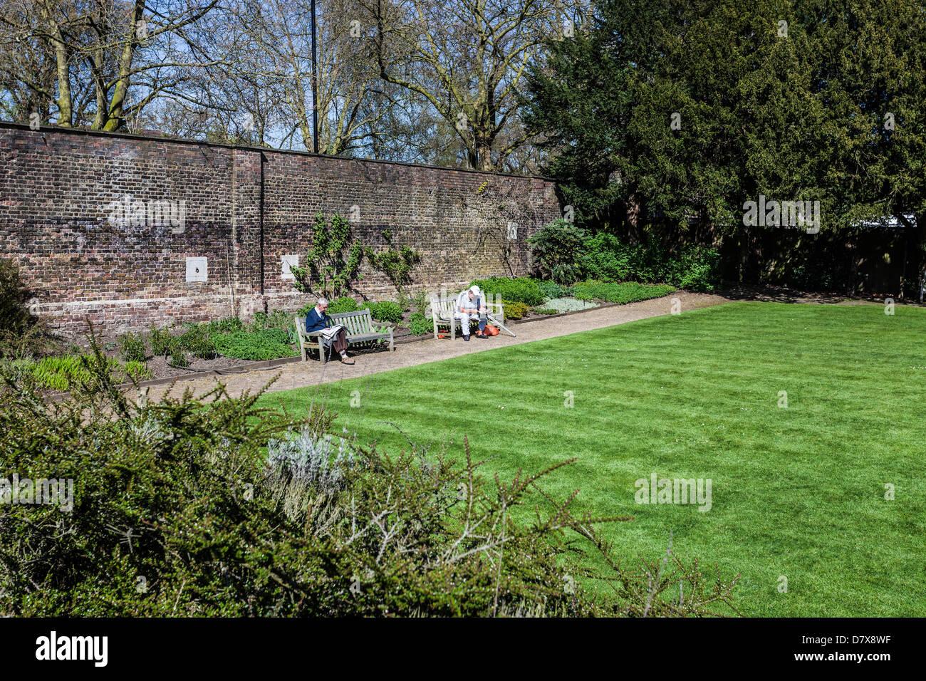 Senior visitors enjoying a sunny afternoon at Kitchen Garden, Kenwood, Hampstead Heath, London, England, UK - Stock Image