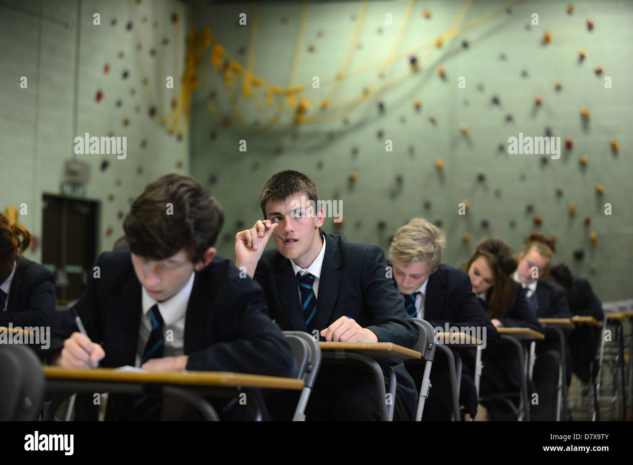 Secondary school pupils sat in a hall in exam conditions GCSE - Stock Image
