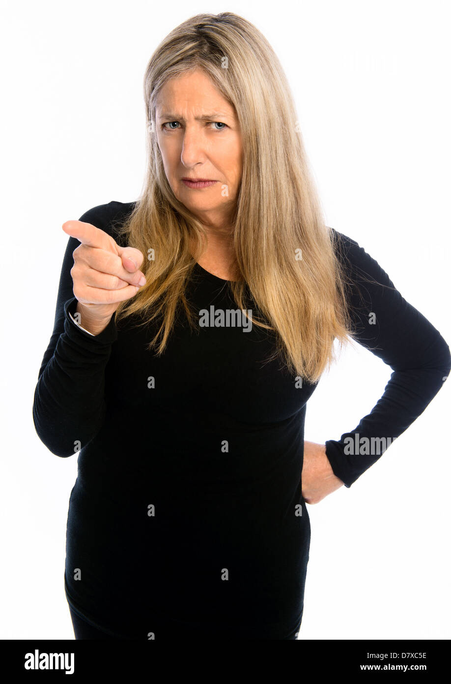 Senior woman wagging finger in front of white background - Stock Image