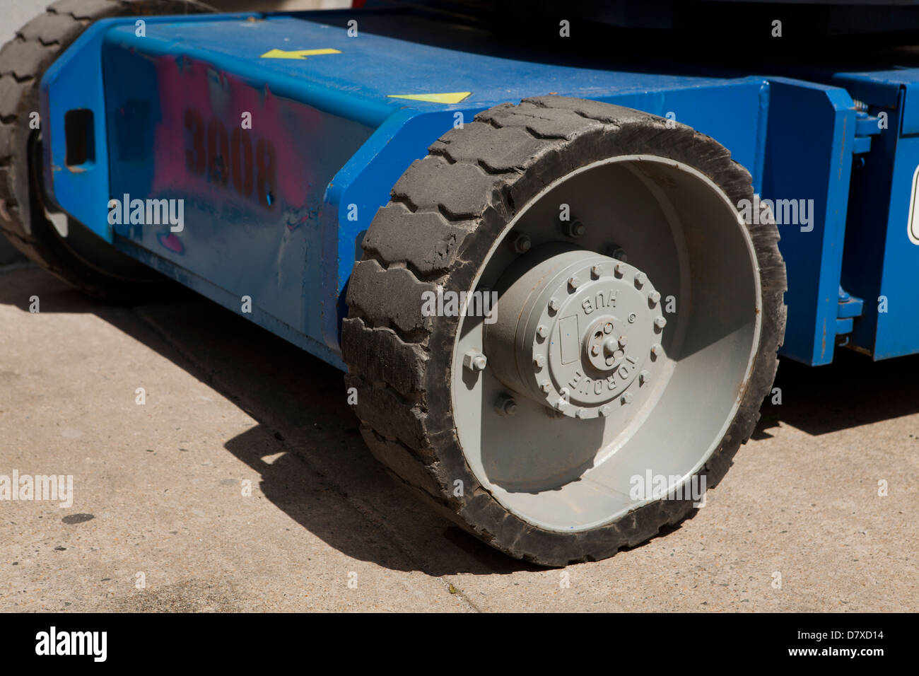 Solid rubber wheel on construction vehicle - Stock Image