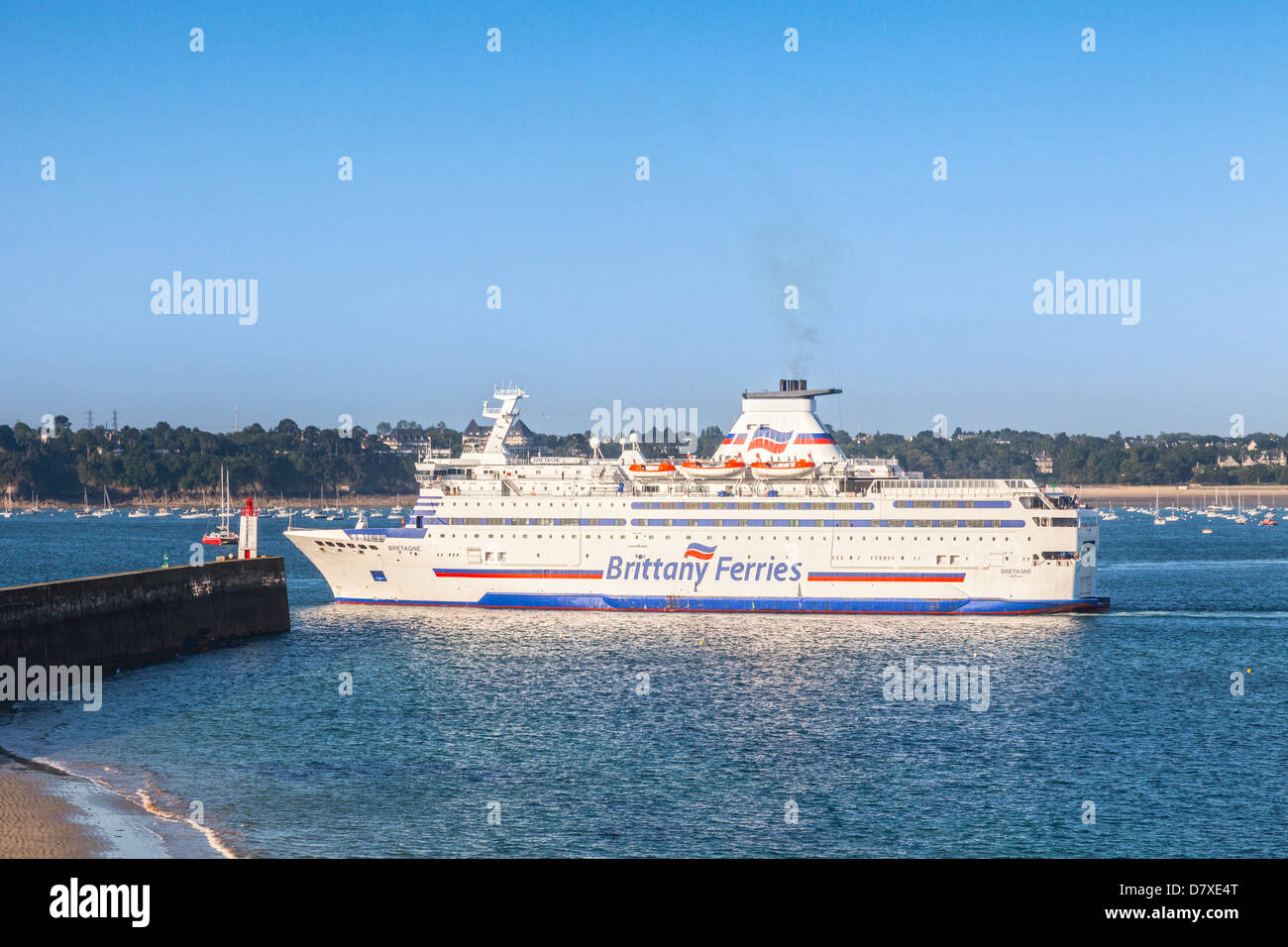 The Brittany Ferries vehicle ferry 'Bretagne' approaches the harbour entrance of St-Malo. - Stock Image