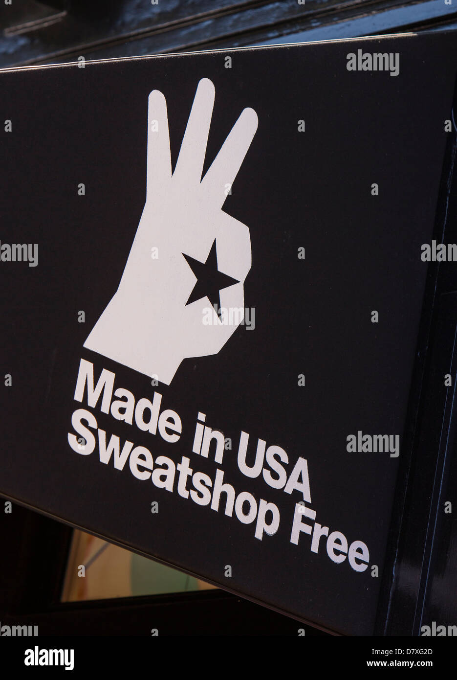 WASHINGTON, DC, USA - Made in USA Sweatshop Free sign at store on M Street in Georgetown neighborhood. - Stock Image