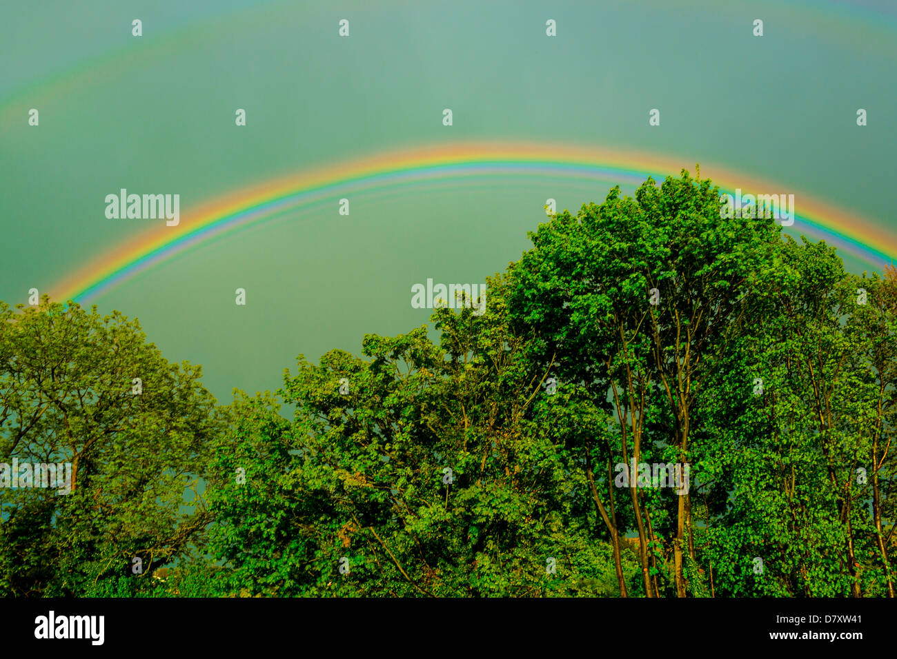 A Rainbow with faint Twin Surrey England - Stock Image