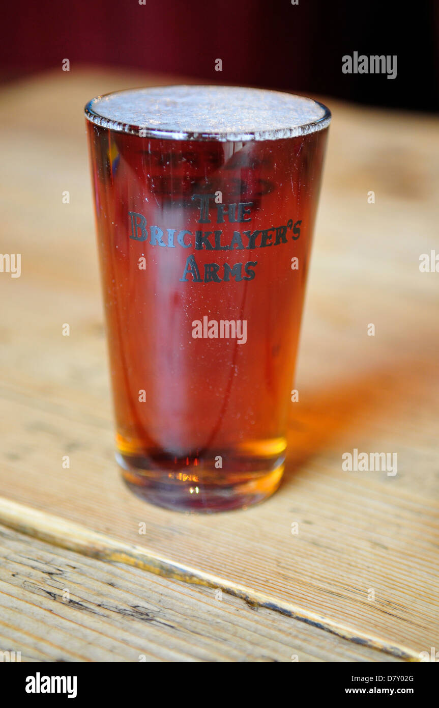 Half pint of beer at The Bricklayers Arms Pub, Putney, London, UK - Stock Image