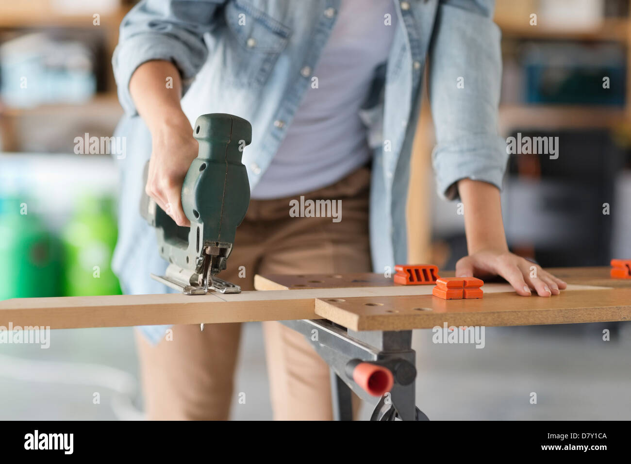 Woman working in workshop Stock Photo