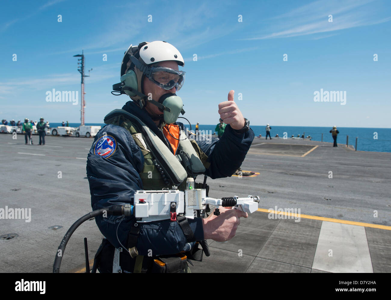 Dave Lorenz, a deck operator for Northrop Grumman, acknowledges that he has control of an X-47B Unmanned Combat - Stock Image