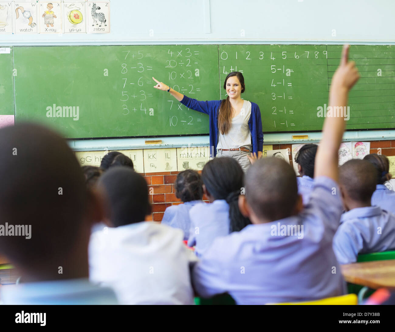 teacher talking to students at chalkboard stock photo 56528987 alamy