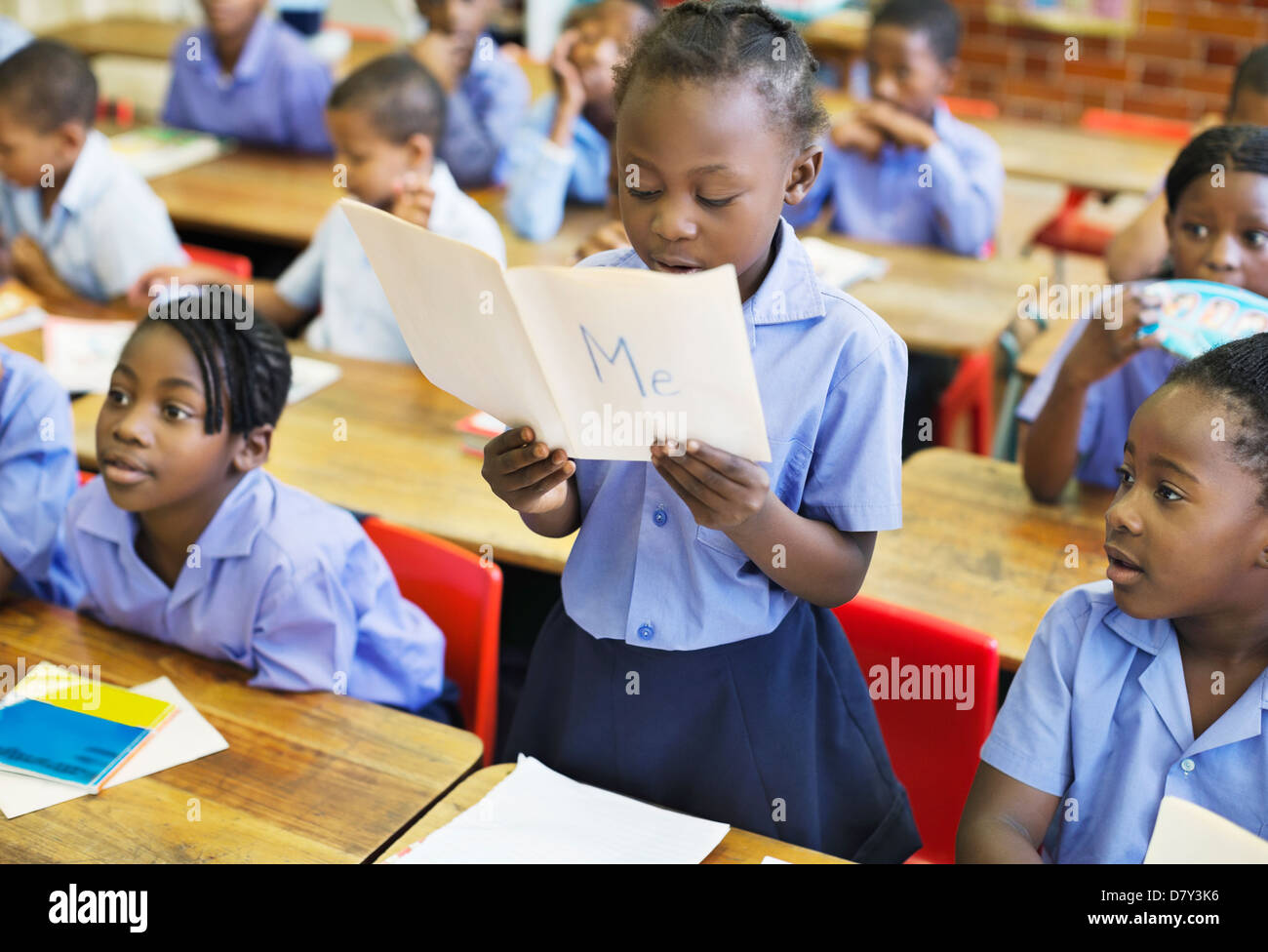 Student reading aloud in class - Stock Image