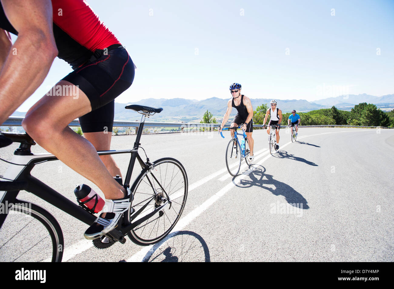 Cyclists in race on rural road - Stock Image