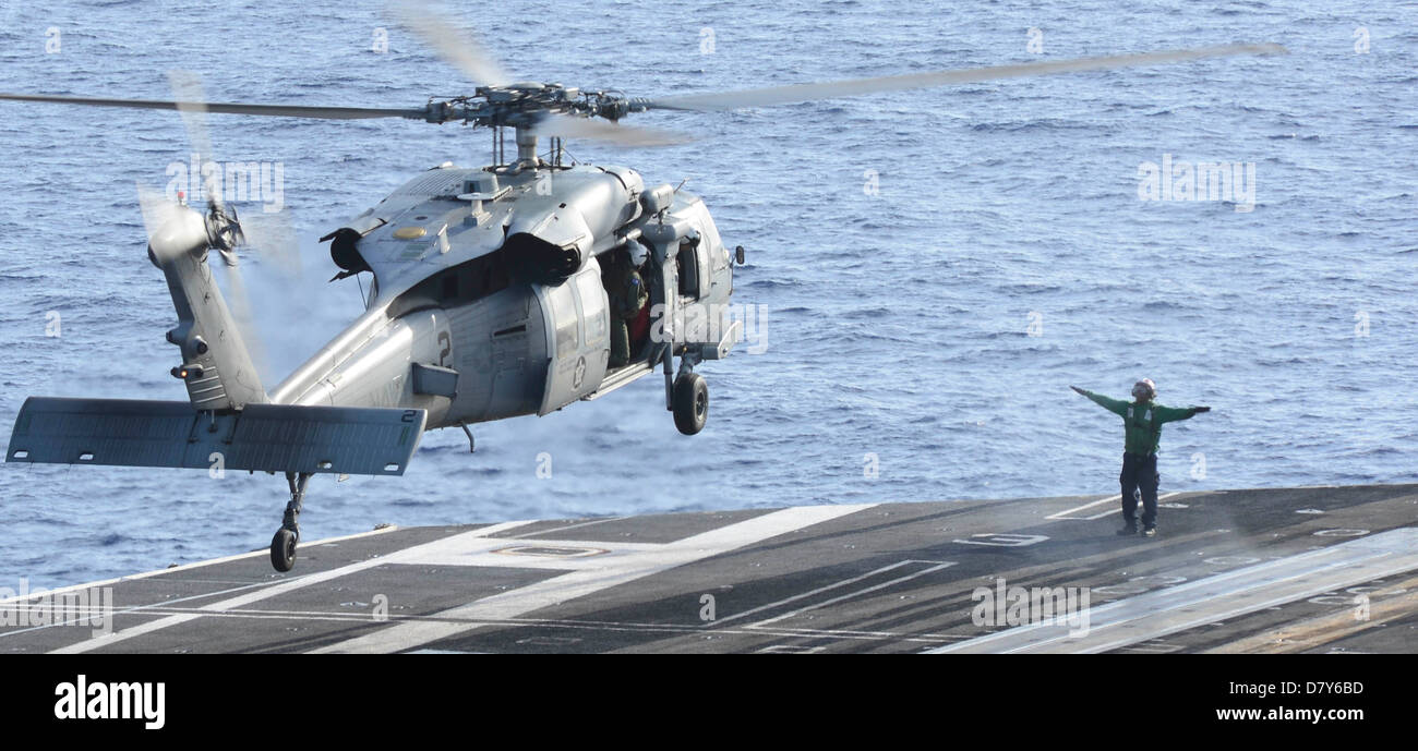 Sea Hawk lands aboard USS Nimitz. - Stock Image