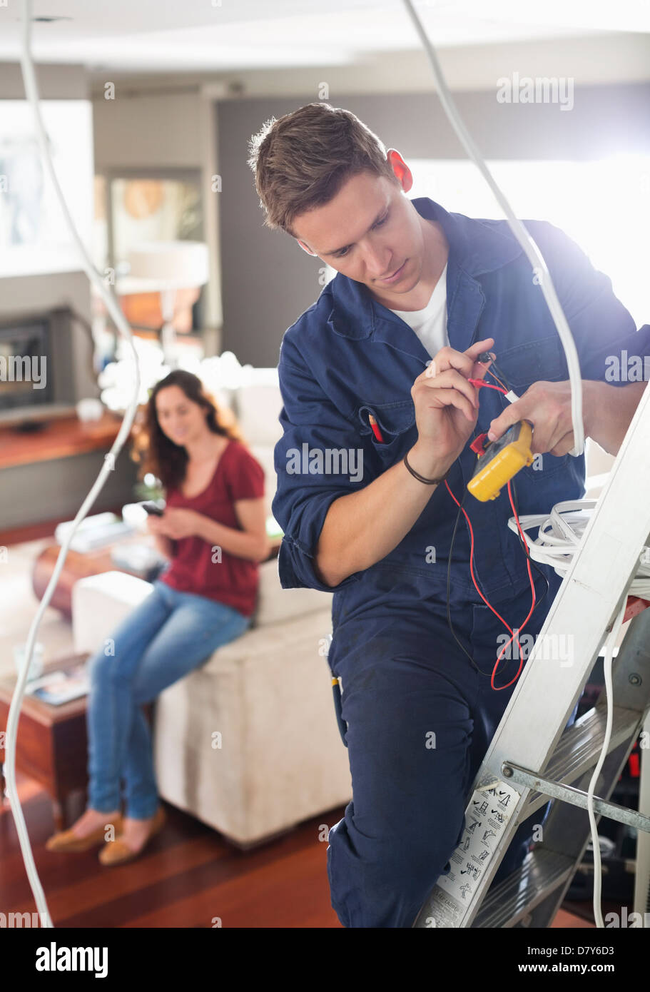 Electrician working in home Stock Photo: 56531471 - Alamy