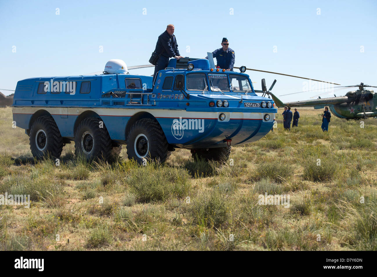 A Russian all terrain vehicle takes Expedition 35 crew to a helicopter from the Soyuz TMA-07M spacecraft shortly - Stock Image