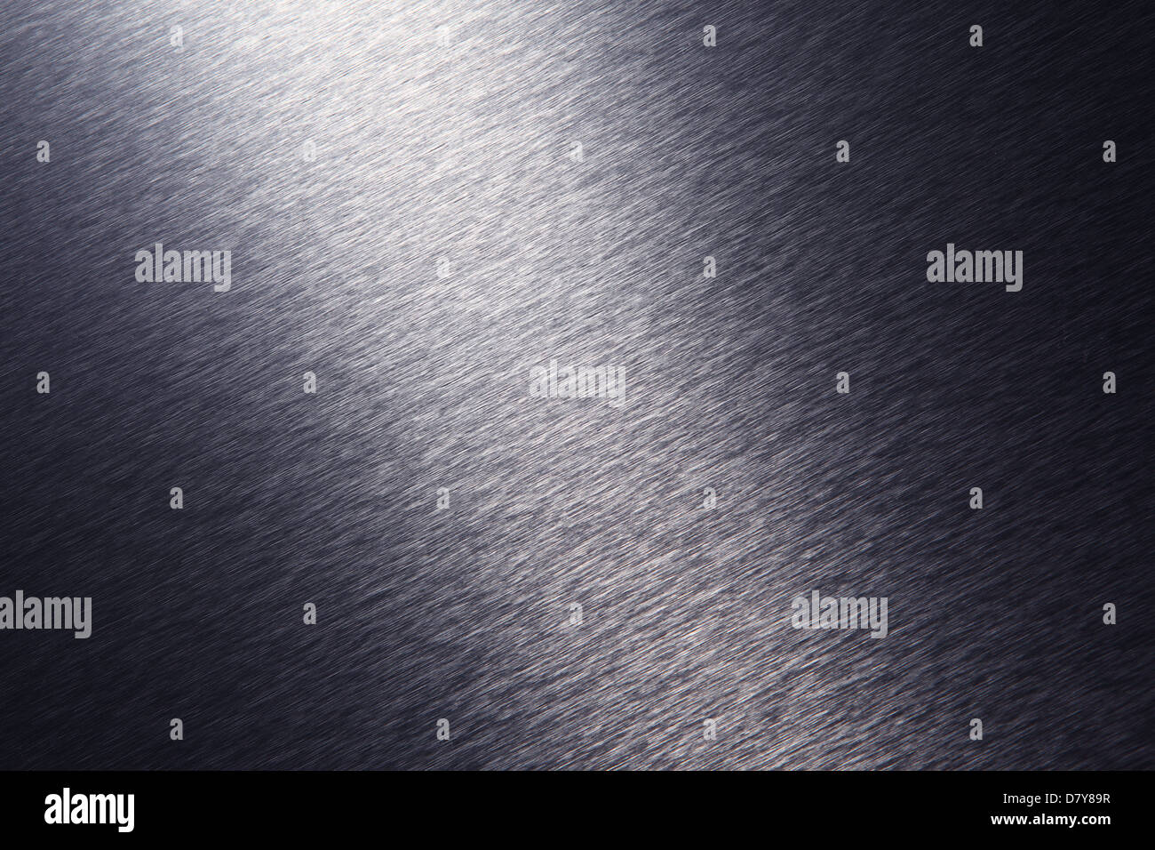 A close-up view of a brushed stainless steel surface with dramatic lighting. - Stock Image