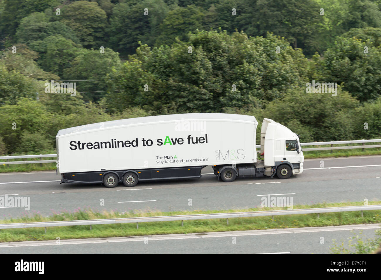 An articulated lorry (HGV) operated by the retailer Marks and Spencer. The vehicle is streamlined to cut carbon - Stock Image