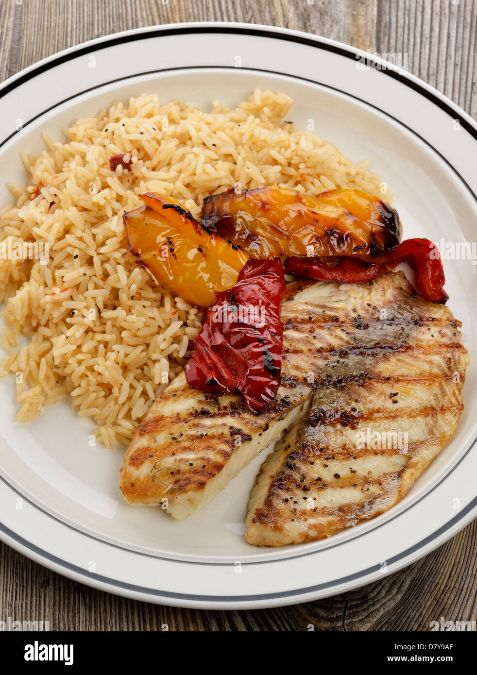 Grilled Tilapia Fillet With Rice And Vegetables Stock Photo Alamy