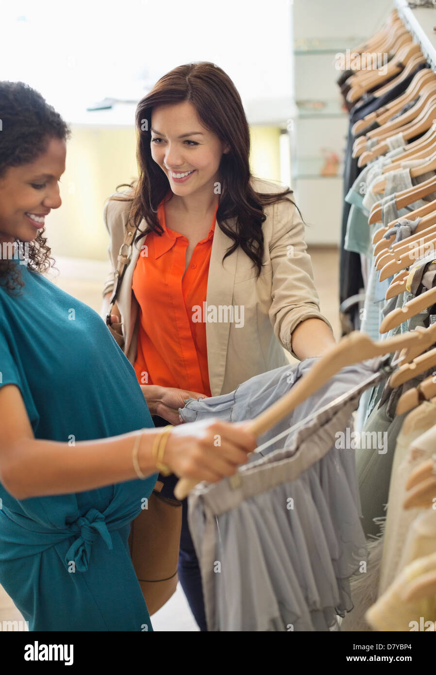 1c543a7cc2 Women shopping together in clothes store Stock Photo: 56535644 - Alamy