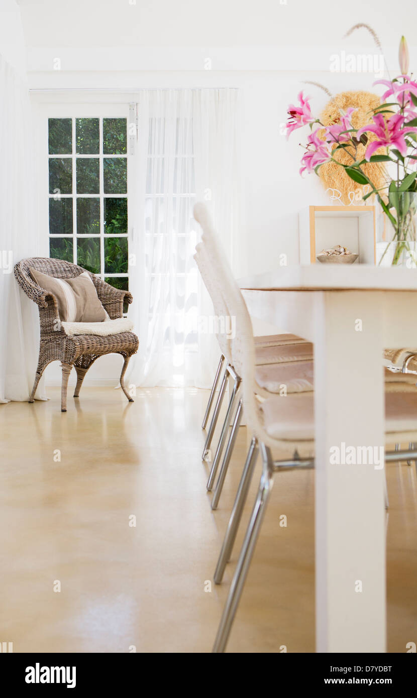 Chairs at table in dining room - Stock Image