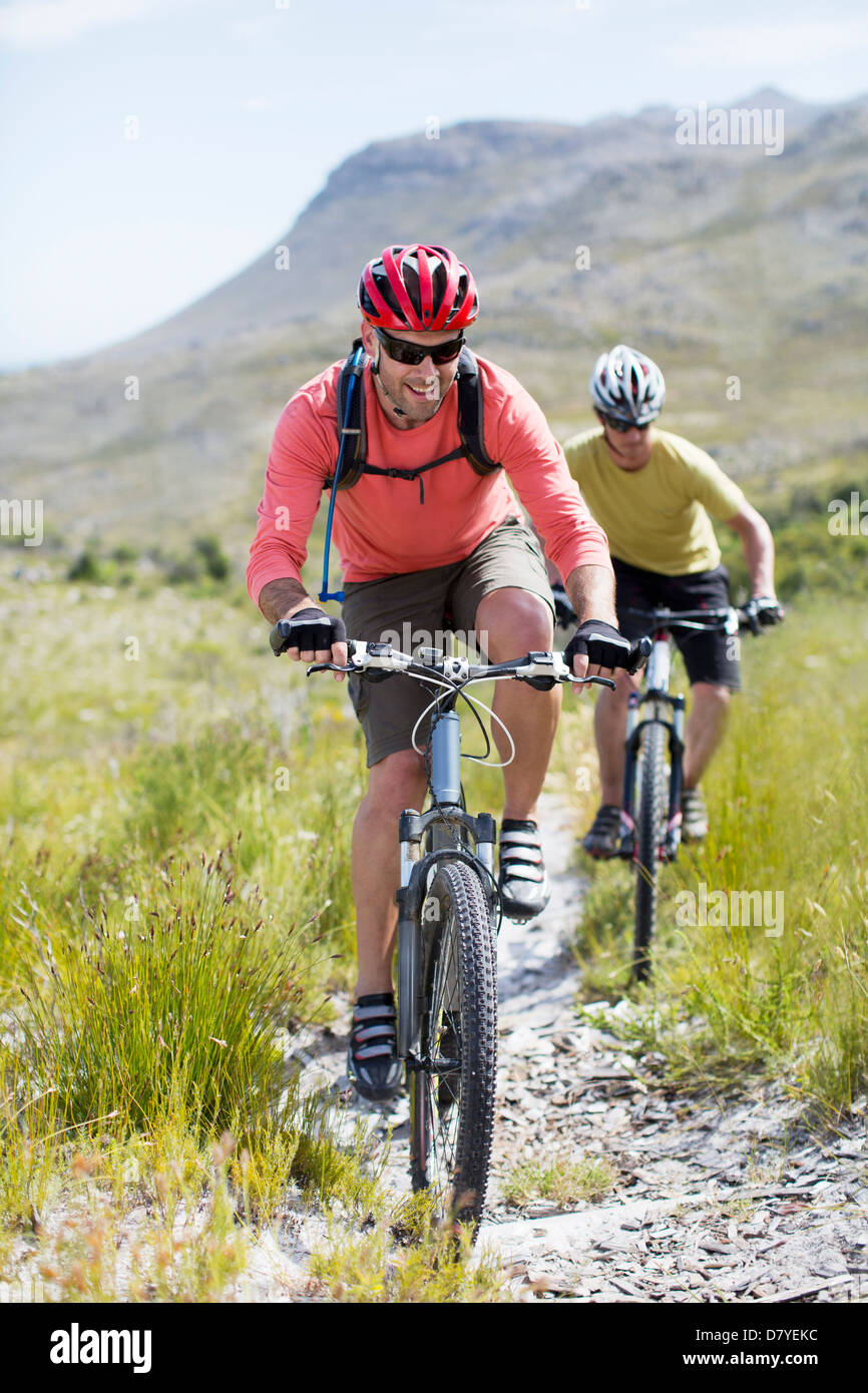 mountain bikers on dirt path - Stock Image