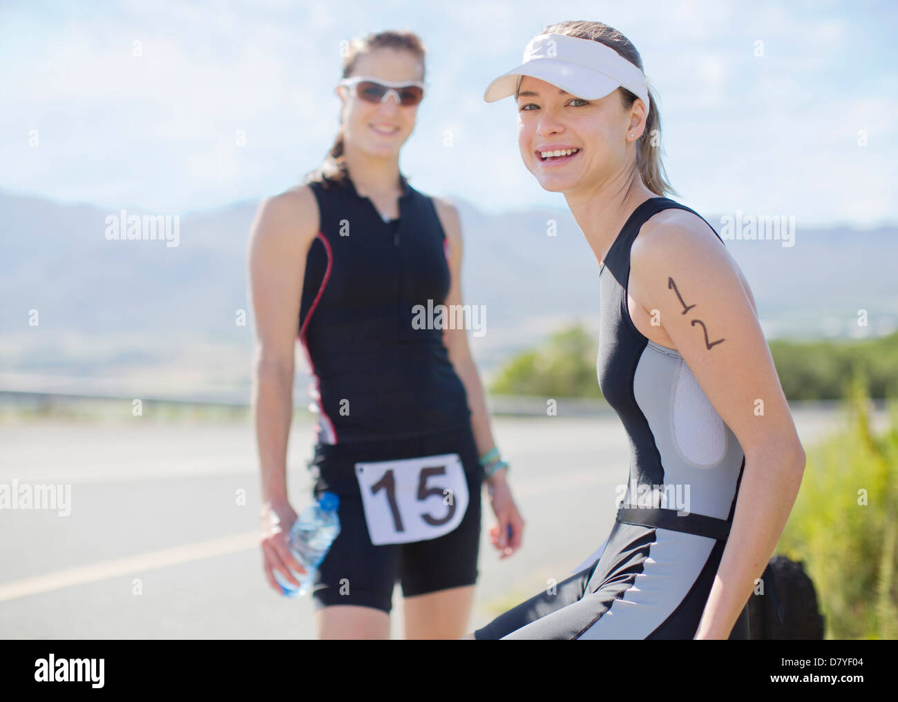 Runners smiling together outdoors - Stock Image