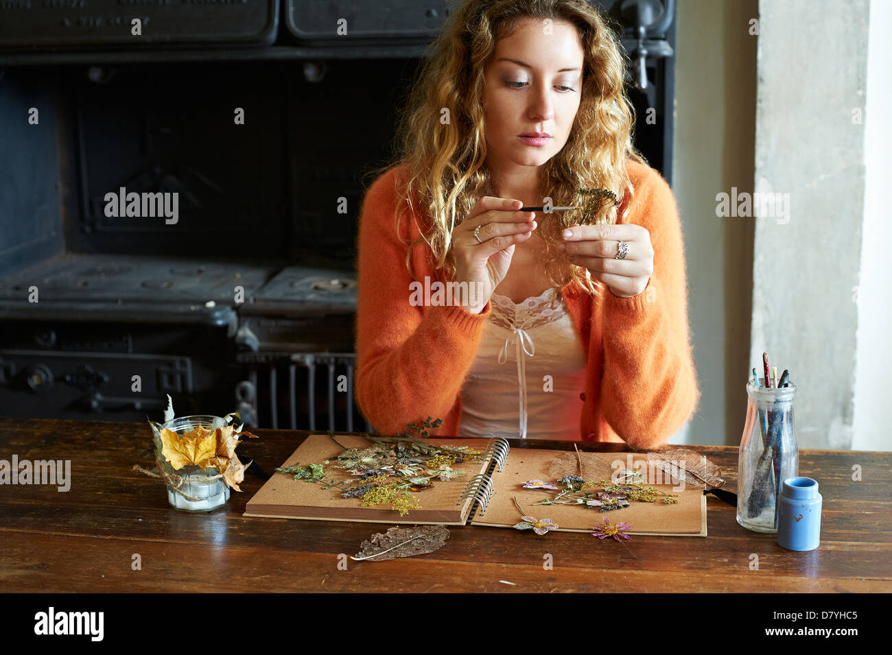 Woman decorating dried herbs and flowers - Stock Image