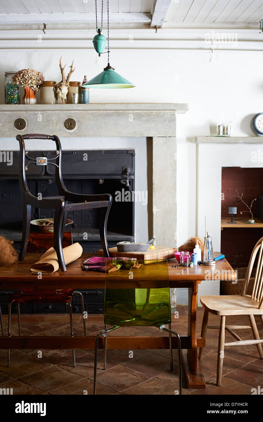 Chair with upholstery supplies on table - Stock Image