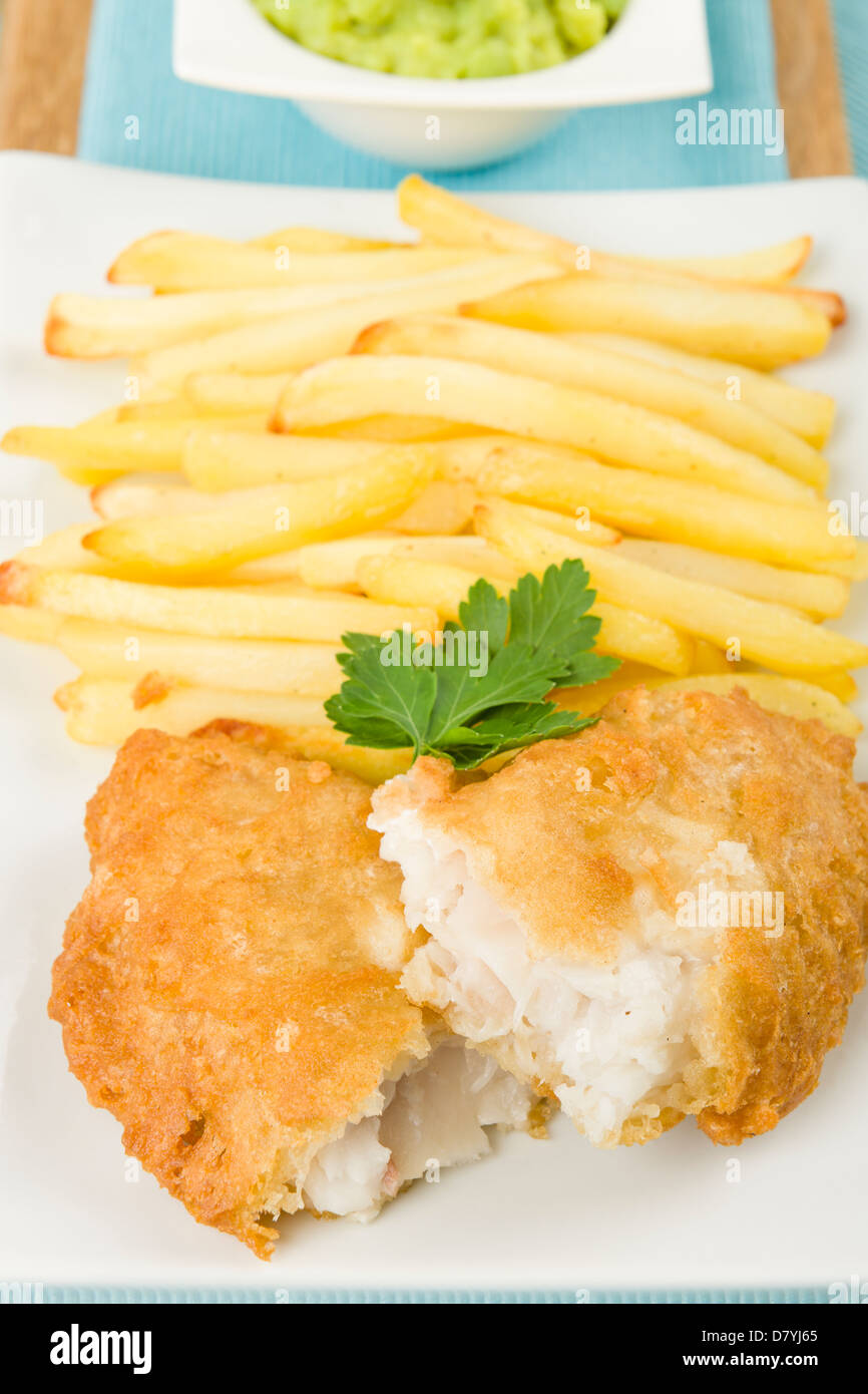 Fish & Chips - Battered cod fillet, chips and mushy peas. - Stock Image