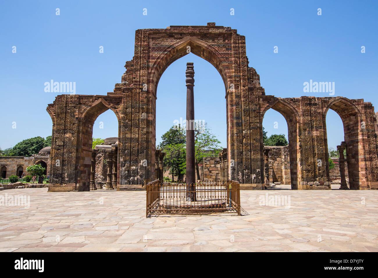 Iron Pillar of Delhi at the Qutub Minar Complex, Delhi, India - Stock Image