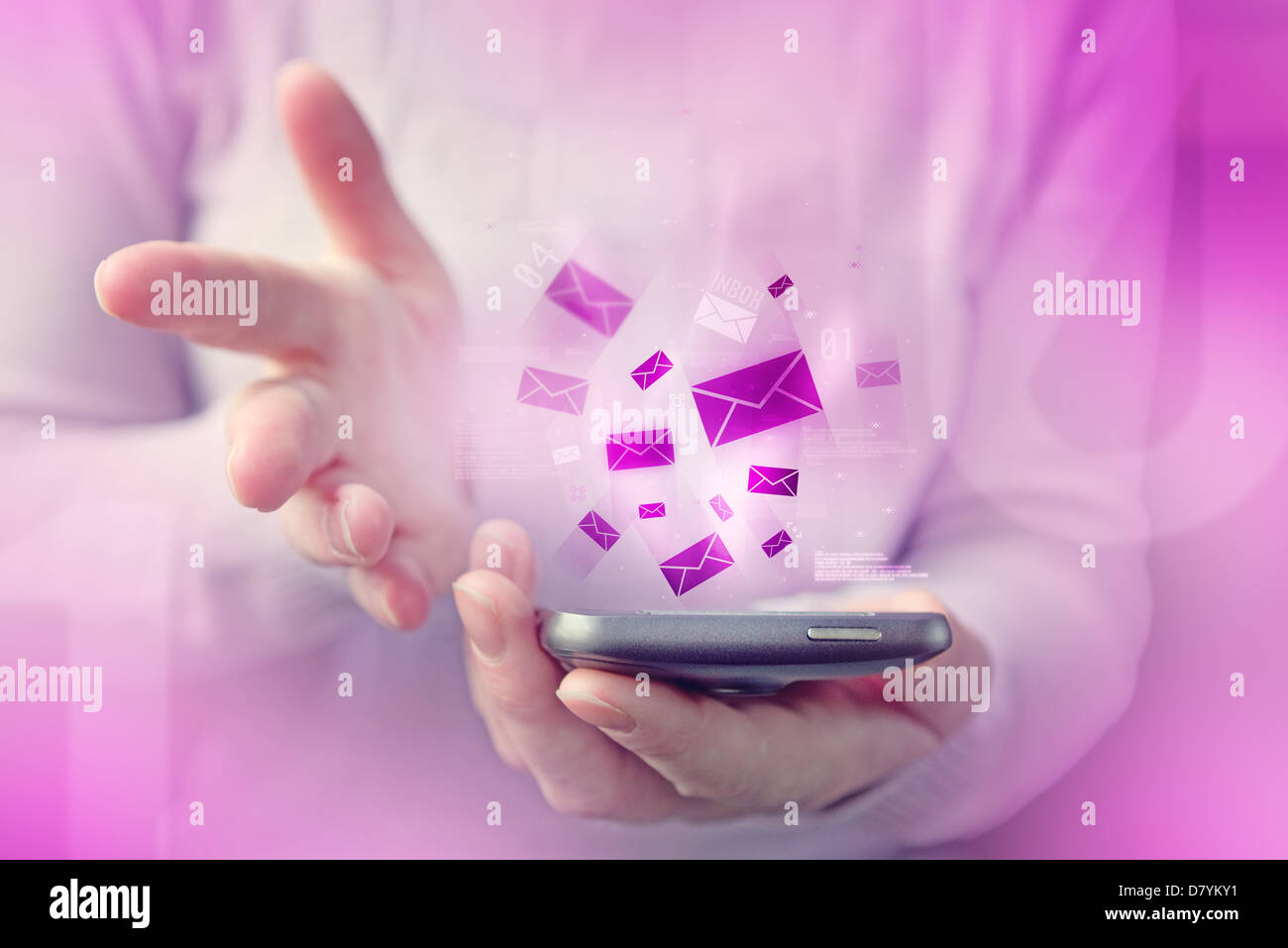 Woman is typing text message on her smartphone, close up image with focus on phone device and e-mail inbox envelopes. - Stock Image