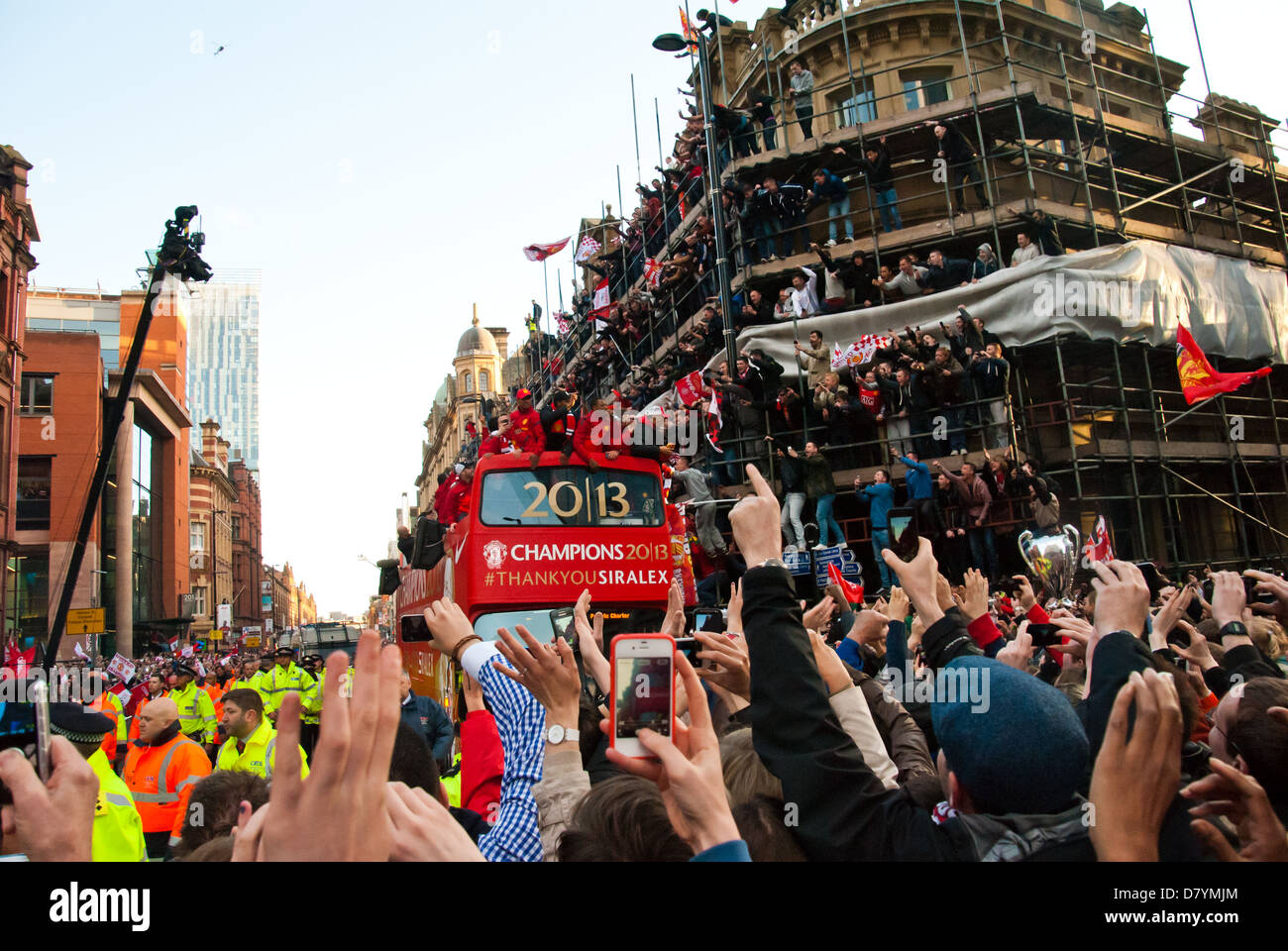 Supporters celebrate at Manchester United's Premier League victory parade. - Stock Image