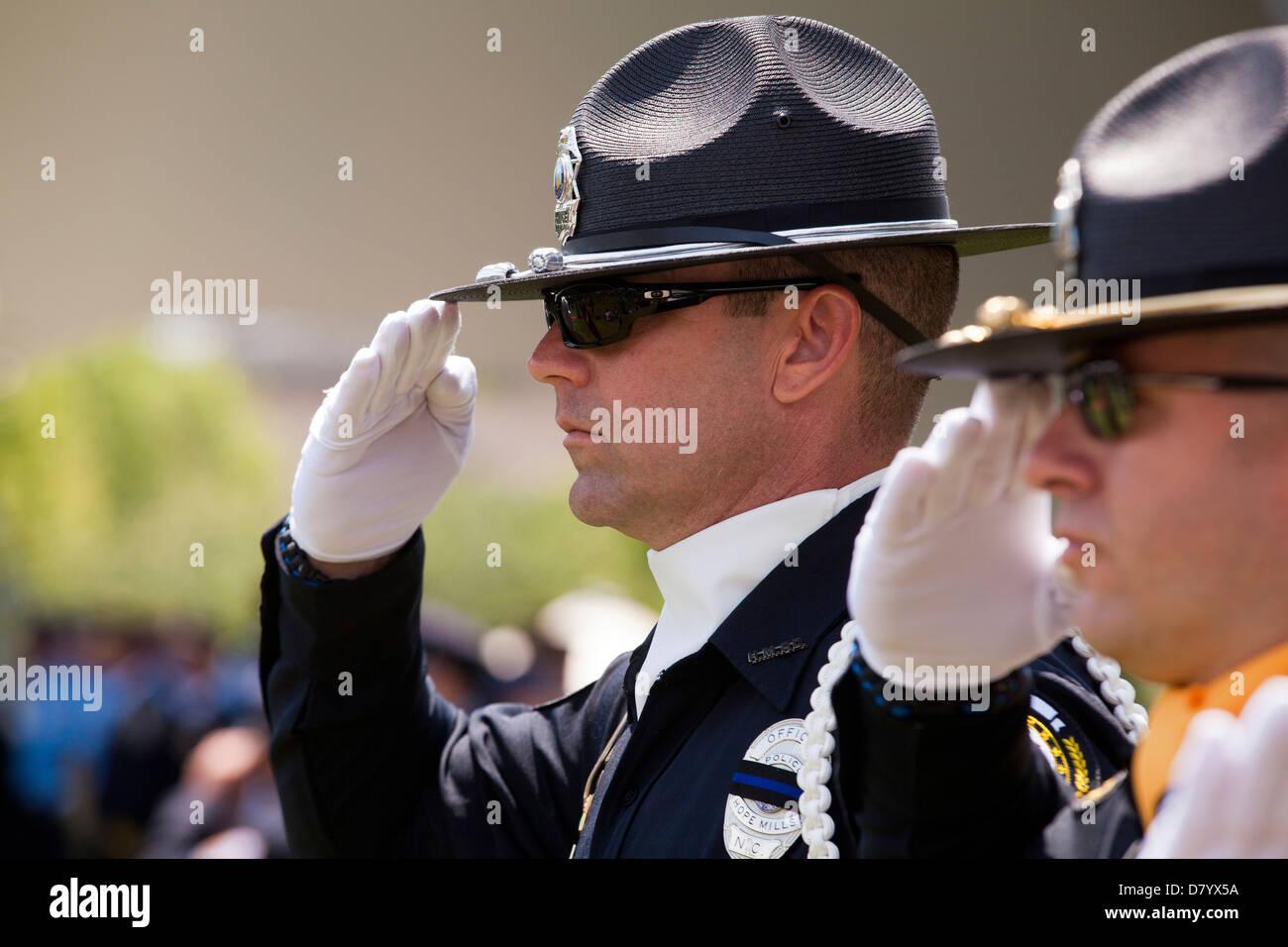 Policemen saluting - Washington, DC USA - Stock Image