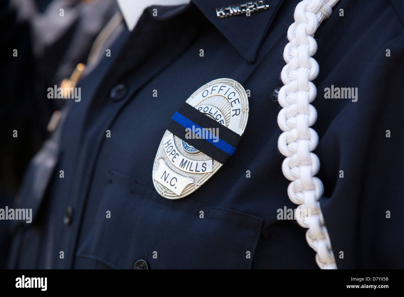 Mourning band across policeman's badge - Stock Image