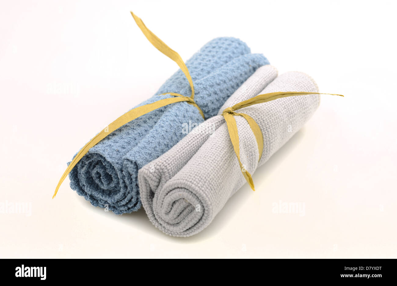 Wash cloths rolled up for spa treatment on white background Stock Photo