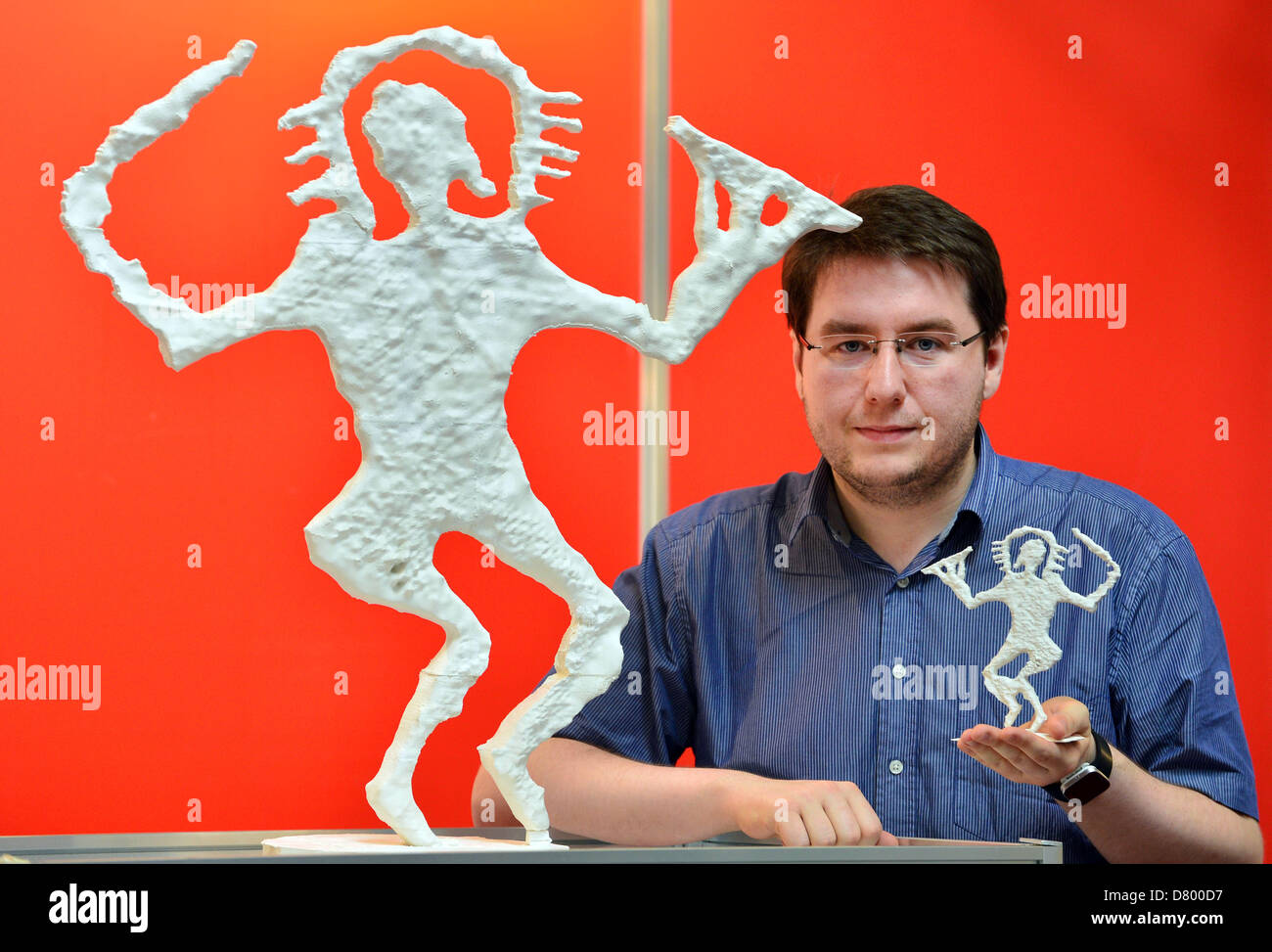 Marcel Karnapke presents a plastic showpiece manufactured in using 3-D printing is on display at the trade and consumer - Stock Image