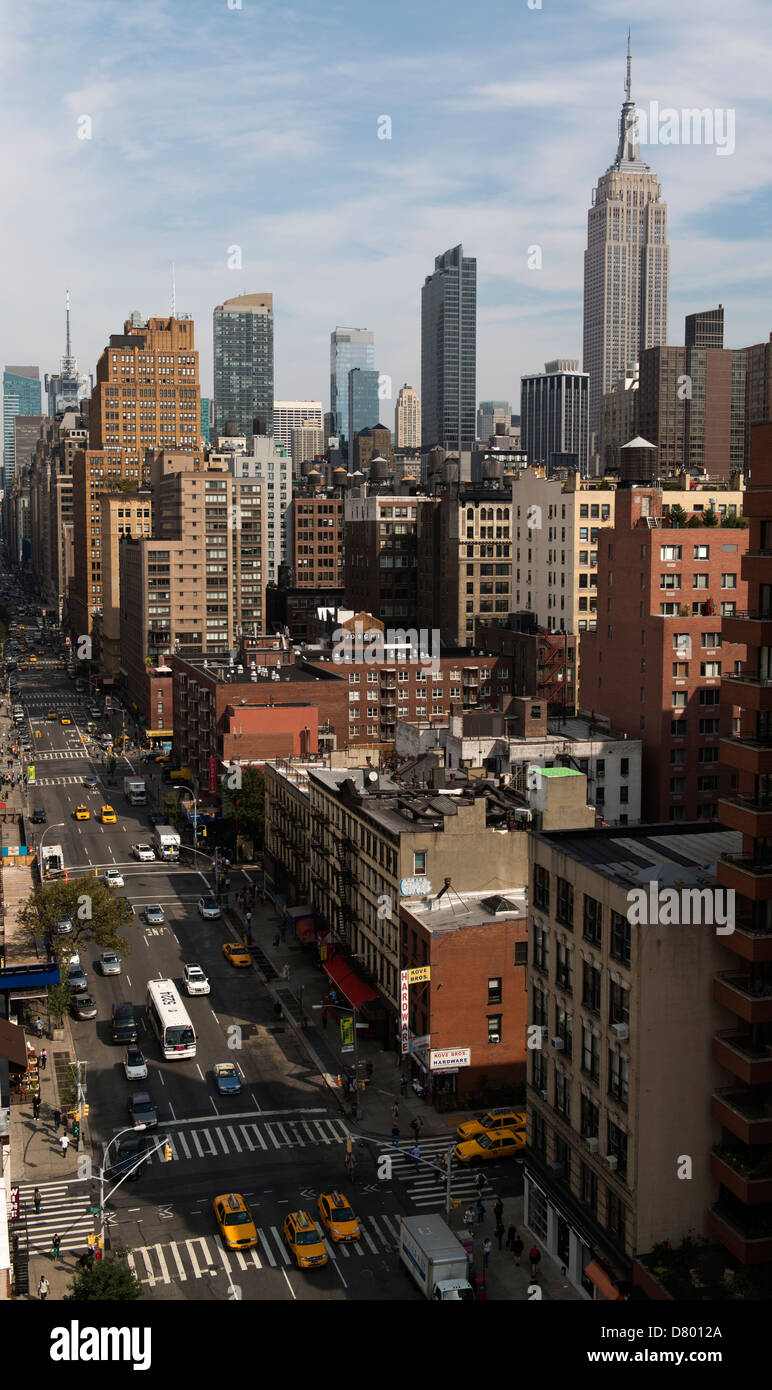 Looking up 7th Avenue on a sunny day with a blue sky. - Stock Image