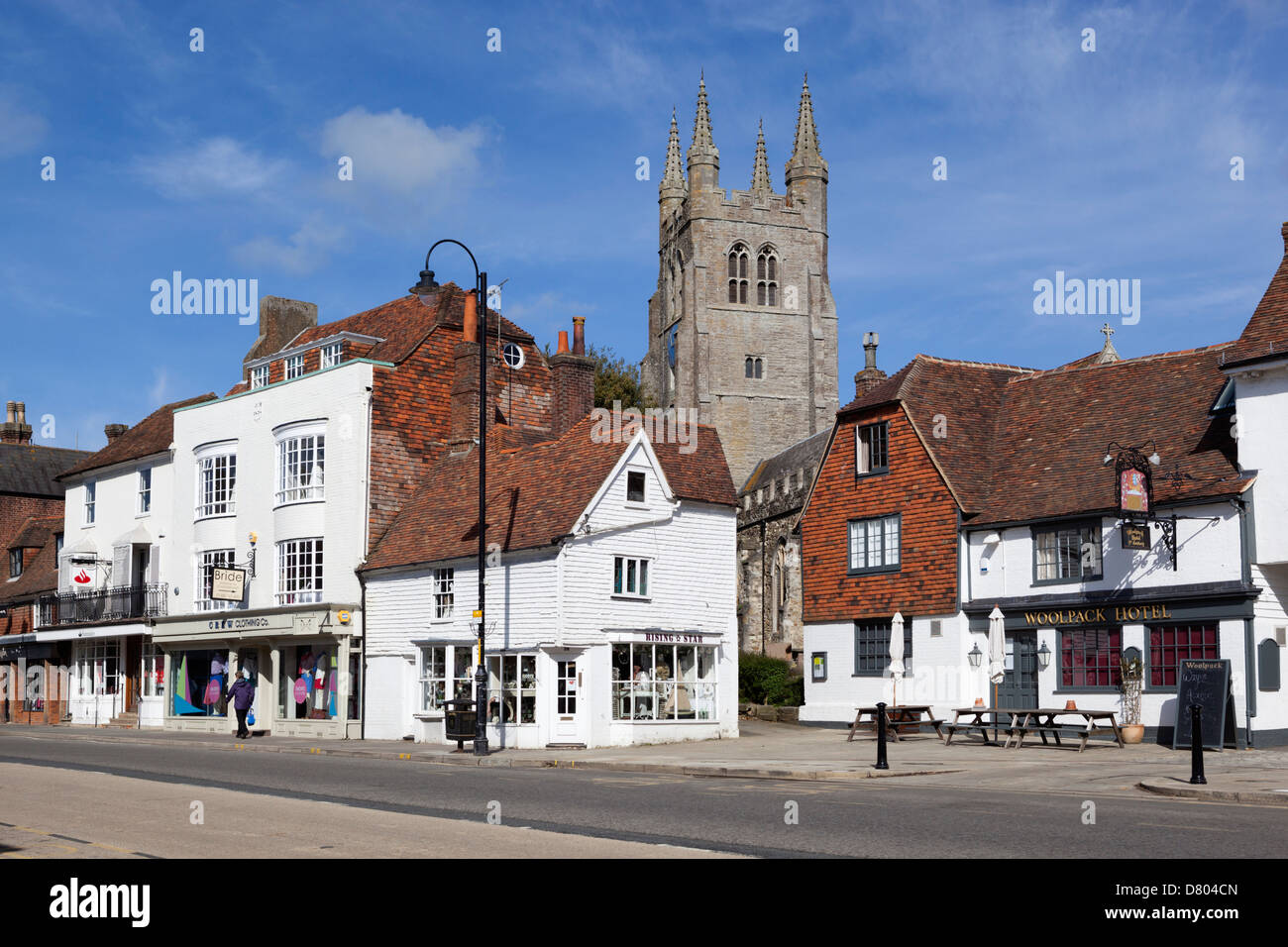 View of church and High Street with Woolpack Hotel - Stock Image
