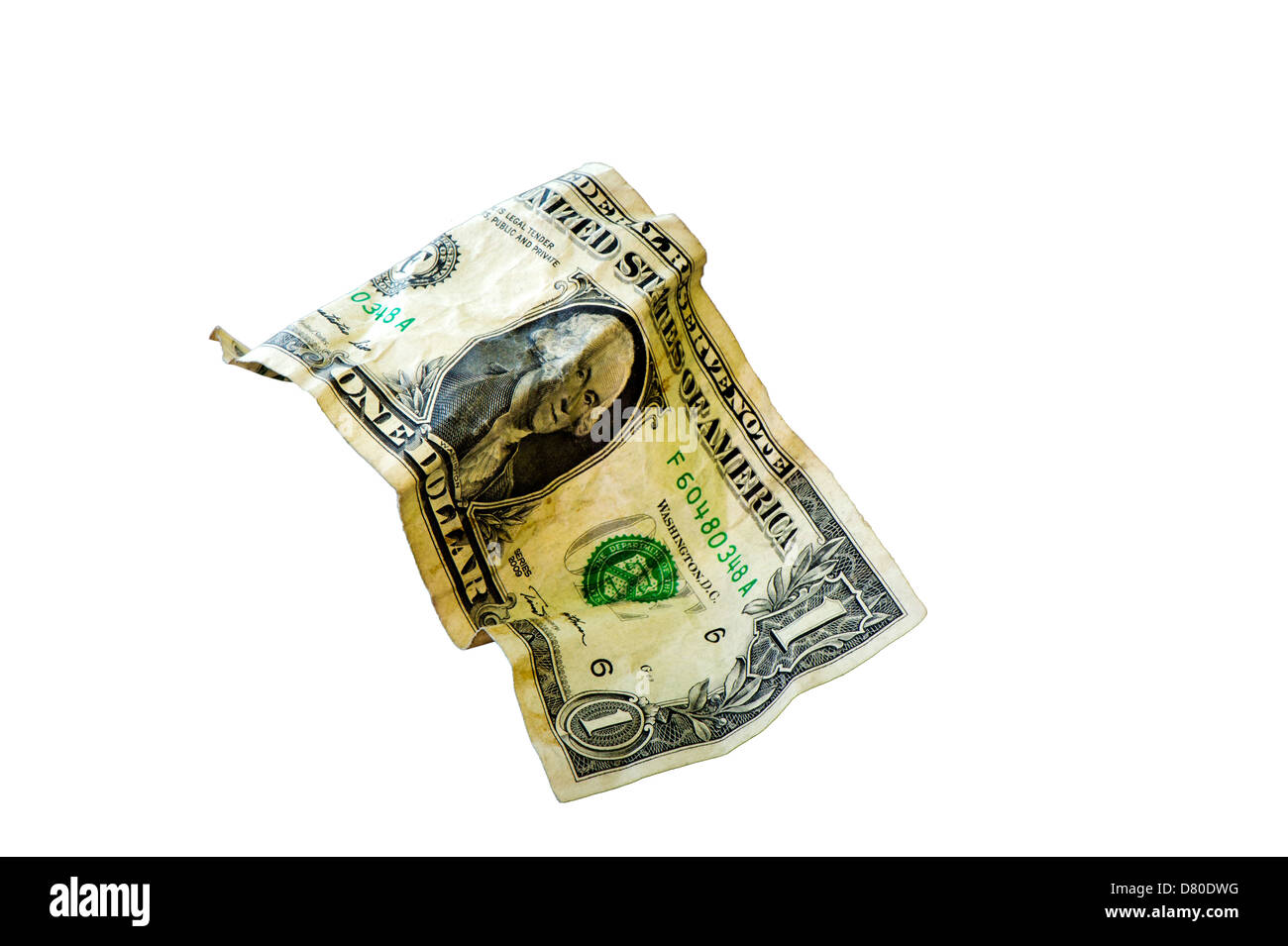 A single, crumpled dollar bill found on the floor of a super market. - Stock Image