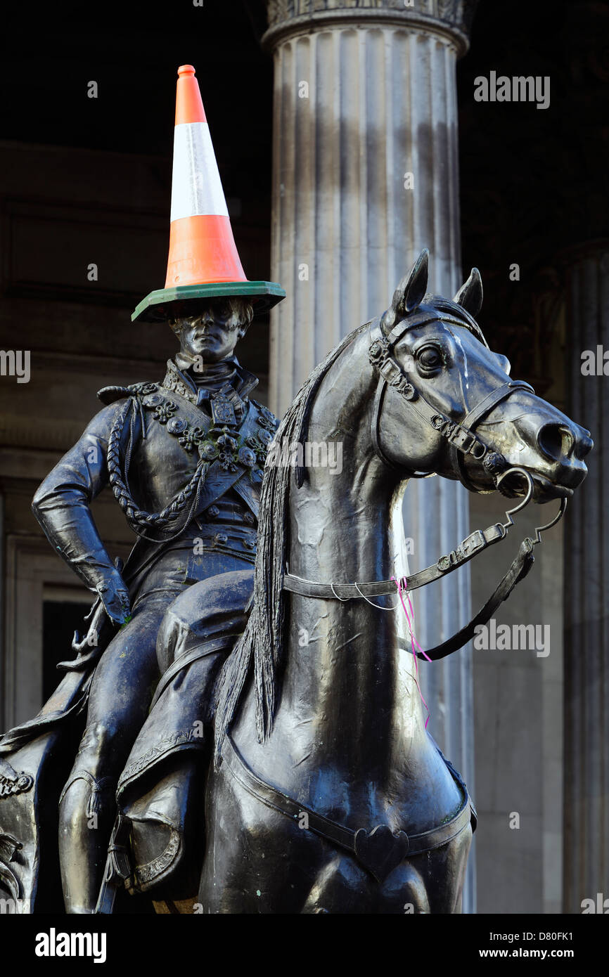 The Duke of Wellington statue with a cone on it's head, Glasgow, Scotland, UK - Stock Image