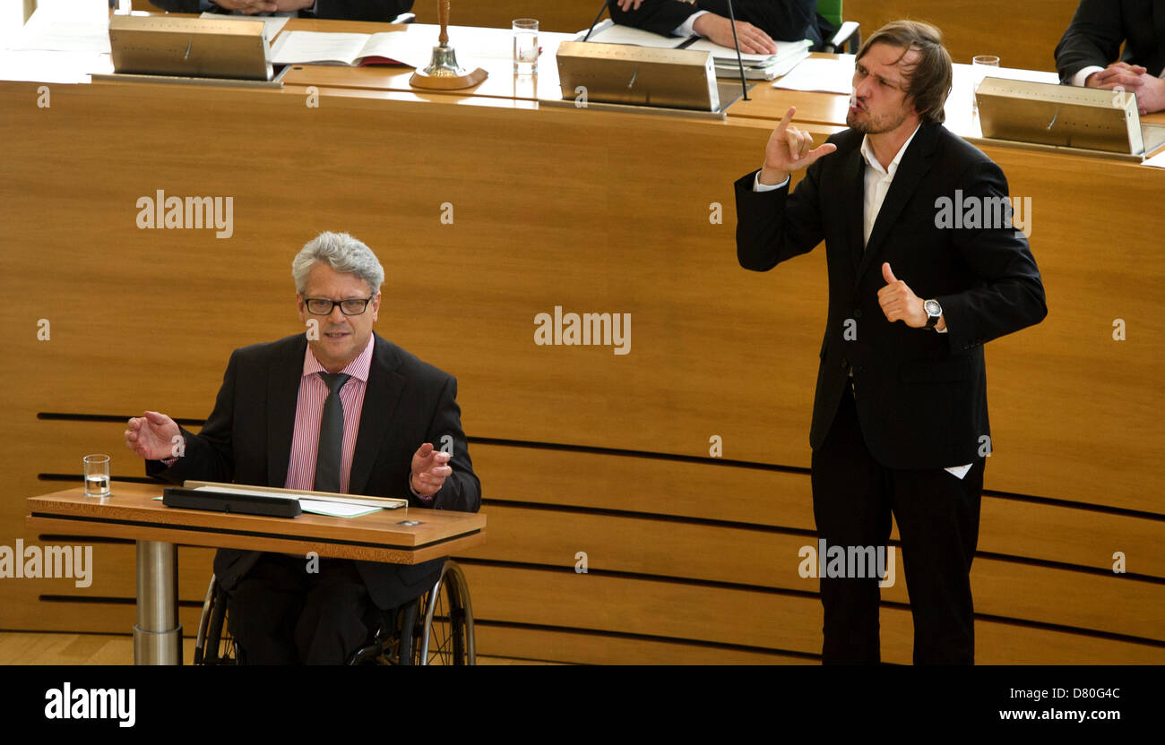 Sign language interpretor Andreas Mischke interprets the speech by parliamentarian Horst Wehner about the bill - Stock Image