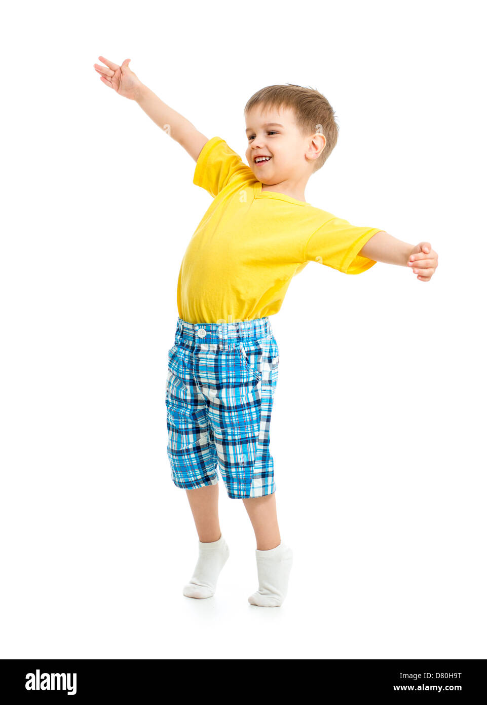 Funny kid boy with open arms isolated on white studio shot. - Stock Image
