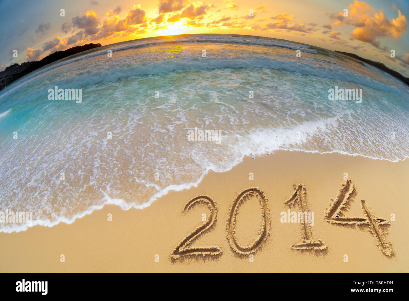 new year 2014 digits on ocean beach sand - Stock Image
