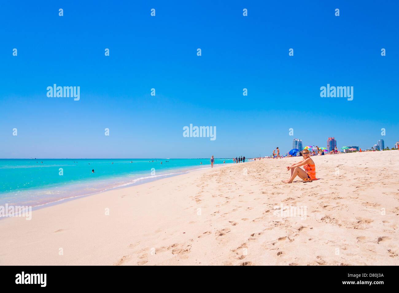 Caucasian woman, 45 years, sitting on a beach, South Beach, Miami Beach, Florida, USA - Stock Image