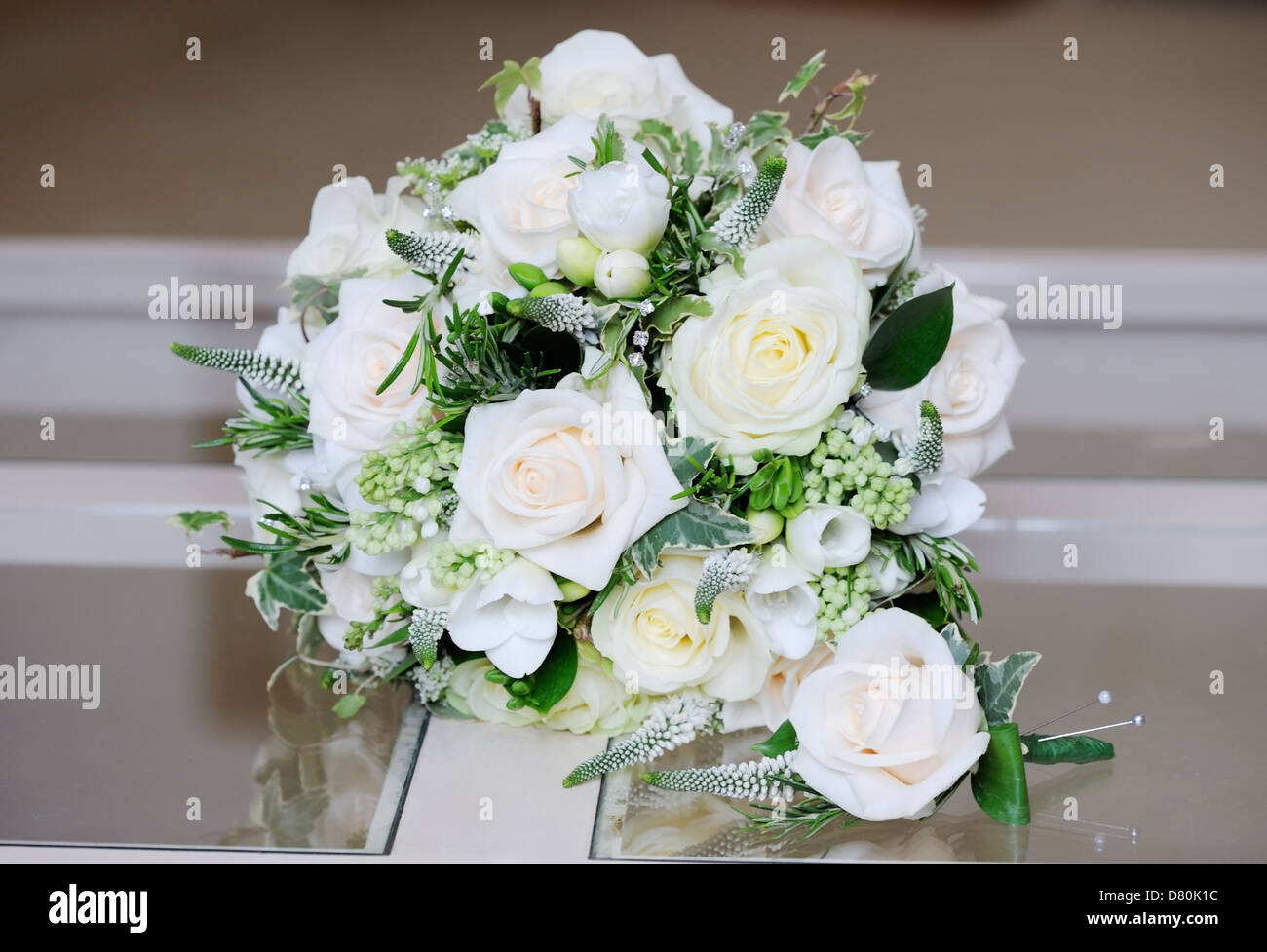Close up of brides flowers and grooms single rose on wedding day close up of brides flowers and grooms single rose on wedding day izmirmasajfo