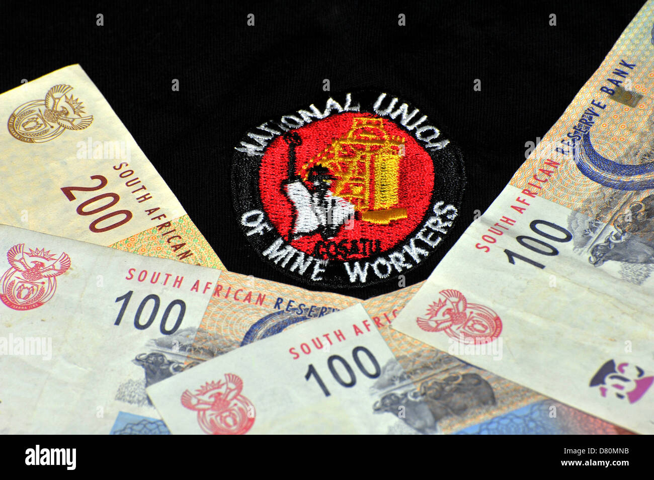 Images of the logo of the South African NUM (National Union of Miners) on textile. - Stock Image